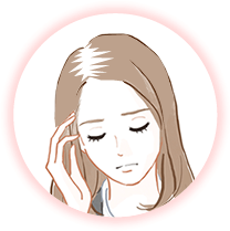 抜け毛に悩む女性のイメージ